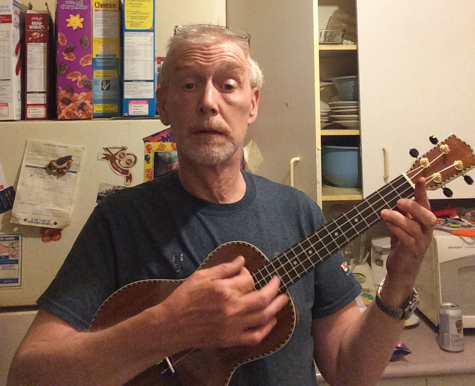 Peter Timusk with Mainland tenor Ukulele in from of fridge